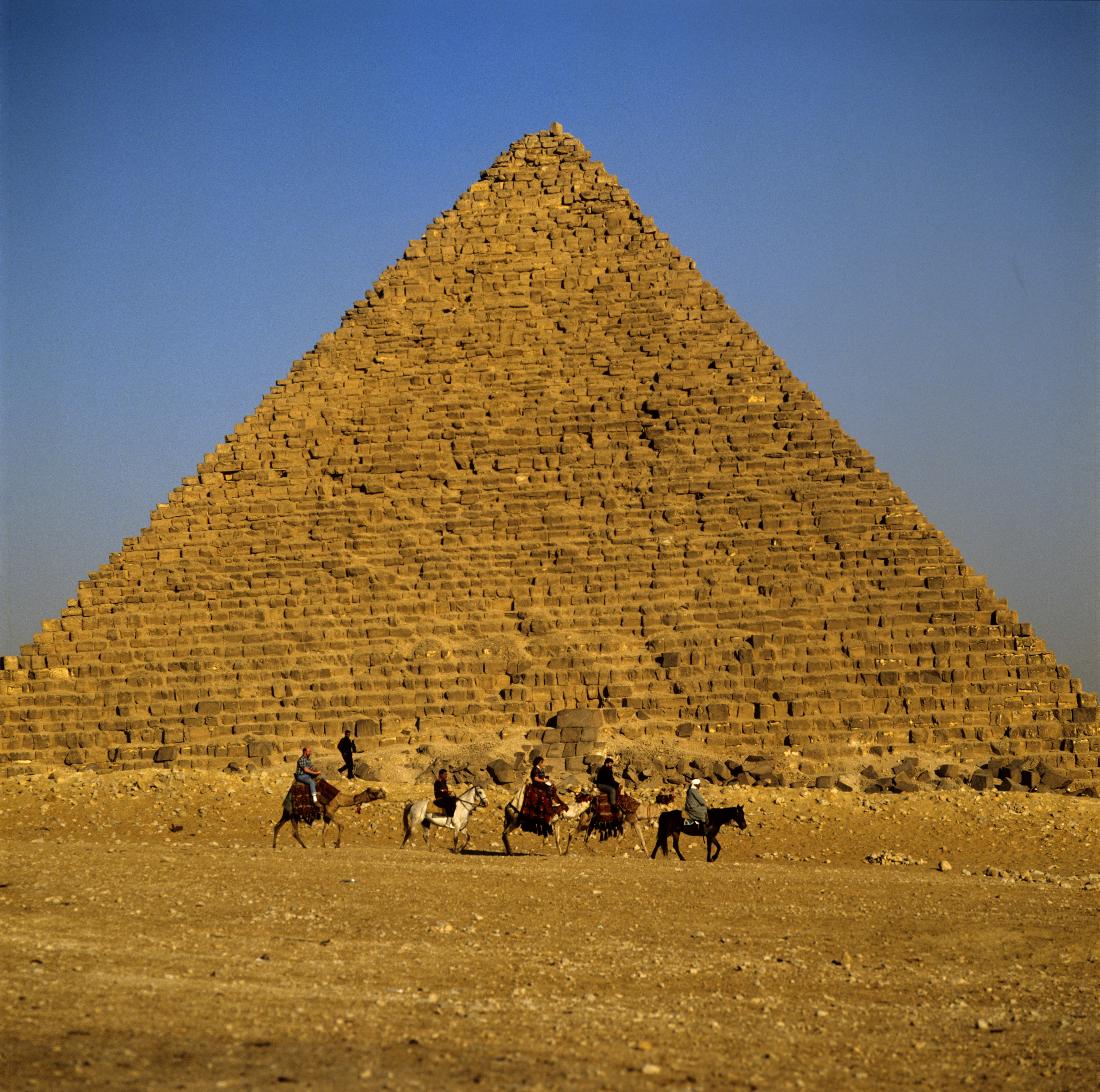 Bedouin with tourists in front of the Pyramid of Menkaure